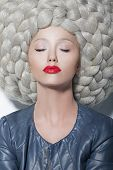 Fantasy. Creativity. Portrait Of Trendy Woman In Futuristic Sumptuous Huge Wig With Braids