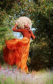 foto of flutter  - Extravagant Woman in Fluttering Dress and Luxurious Wig with False Hairs - JPG