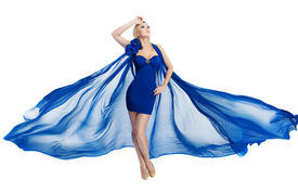 stock photo of flutter  - Woman beauty in blue fluttering dress waving on wind isolated over white background - JPG