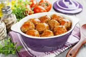 stock photo of meatballs  - Meatballs in tomato sauce in the pot - JPG