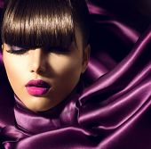 Fringe. Fashion Model Girl With Trendy Hairstyle. Haircut. Stylish Beauty Brunette Woman on violet s