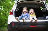 Laughing Toddler Girls Sitting In The Car