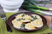 Homemade ravioli stuffed with ricotta and spinach