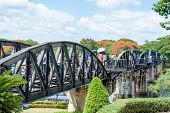 Kanchanaburi, Thailand - May 23, 2014: Tourists Visiting The Bridge Over River Kwai In Kanchanaburi,