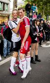 Gay Couple In Heels, Dressed As Football Players.