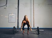 Fit Female Athlete Performing A Deadlift