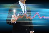 Businessman Hand Pushing A Business Graph
