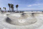 VENICE BEACH, CALIFORNIA - JUNE 21 : Deep concrete ramps and palm trees at the popular public skate