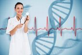 Pretty nurse listening with stethoscope against blue medical background with dna and ecg