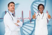 Composite image of happy medical team against blue medical background with dna and ecg