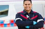 portrait of male paramedic with arms crossed