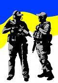 Soldier in uniform with gun on ukrainen flag