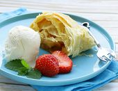 traditional apple strudel with raisins, served with a scoop of ice cream