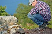 Mature tourist watching the tortoise on the Heaven island near Marmaris, Turkey