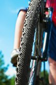 Biking Over Rough Terrain. Focus On A Bicycle Tire.