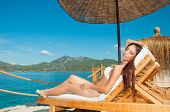 Girl Sunbathing In Vip Bungalow Overlooking The Sea