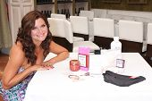 LOS ANGELES - JUN 21:  Heather Tom, with gift bag items at the Leading Ladies of Daytime Luncheon 20