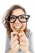 pic of geek  - Funny geek girl eating a cookie isolated on a white background - JPG