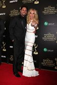 LOS ANGELES - JUN 22:  Don Diamont, Cindy Ambuehl at the 2014 Daytime Emmy Awards Arrivals at the Be