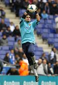 BARCELONA - MARCH, 29: Jose Manuel Pinto of FC Barcelona warm up before a Spanish League match against RCD Espanyol at the Estadi Cornella on March 29, 2014 in Barcelona, Spain