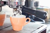 Orange Coffe Cup Prepares For Espresso