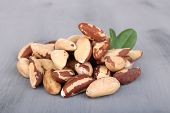 Tasty brasil nuts on wooden background