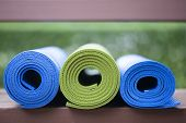 foto of yoga mat  - Colorful yoga mats set aside on the floor - JPG