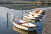 White Boats On Calm Water Surface.