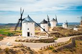 traditional windmills and castle in Consuegra, Toledo, Spain