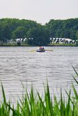 People rowing on the pond