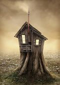 stock photo of scary haunted  - Fantasy tree house in the meadow - JPG