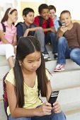 stock photo of school bullying  - Girl being bullied in school - JPG