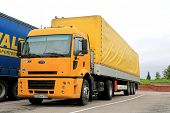 Yellow Ford Cargo 1830 Semi Truck