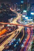 stock photo of seoul south korea  - Night traffic blurs past Seoul Station in Seoul South Korea - JPG