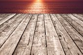 aged wooden pier at sunset