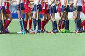 Fair Play concept for sportsmanship, showing two oppsing teams of women field hockey players shaking