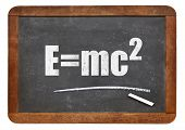 physics education concept - Einstein equation on a small slate blackboard