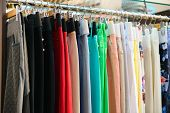 picture of boutique  - Variety of clothes hanging on rack in boutique - JPG