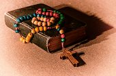prayer book and rosary