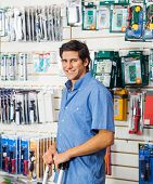 Portrait of smiling young man standing in hardware store