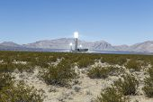 IVANPAH, CALIFORNIA - November 26, 2014:  Three glowing white hot towers at the massive 392 megawatt Ivanpah solar thermal power plant in California's Mojave desert.