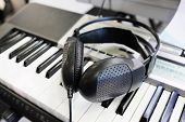 synthesizer and headphones under the white background