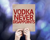 Vodka Never Disappoints written on colorful background with defocused lights