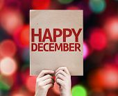 Happy December written on colorful background with defocused lights