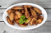 Close Up Deep Fried Chicken Wings On A Wooden Table