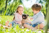 Children in park with pet