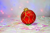 Red Christmas ball on the table