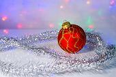 Red Christmas-tree ball and tinsel