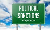 Political Sanctions on Highway Signpost.