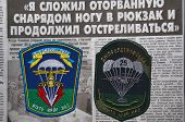 Kiev,Ukraine.Oct 16.Illustrative editorial.Ukranian military paratroopers chevrones .Newspaper with heroic story of soldier as background.At October 16,2014 in Kiev, Ukraine